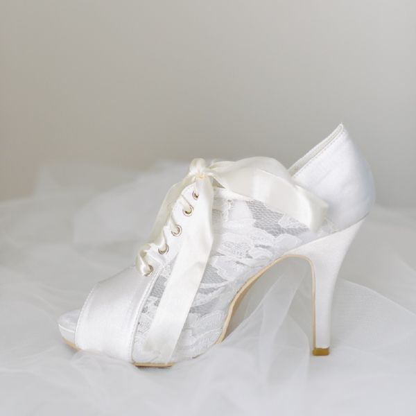 Chantilly Lace Wedding Shoes by Pearl & Ivory ®  - Find more elegant wedding shoes from our collection www.pearlandivory.com/bridal-shoes.html. Photography by Yolande Marx #PearlandIvory #Lace #WeddingShoes #ChantillyBooties #BridalShoes