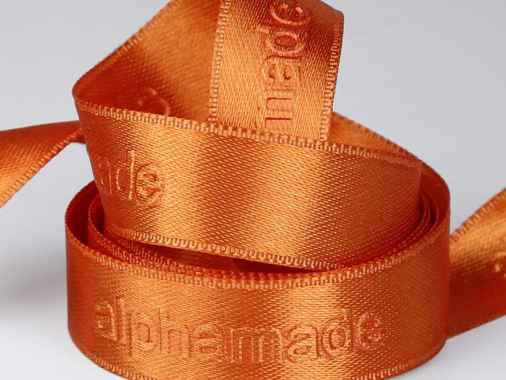 Giftribbon with embossed printing  http://www.minanamnband.se/presentband-shop/satin-presentband-med-egen-logga-och-design