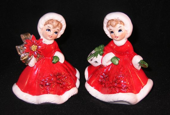 "Listing this evening is 2 little Christmas figurines from the 1950's.  They do not say Napco but have the number 6604 on the bottom.  One is holding a pretty poinsettia and wears her red cloak with the white trim.  The other is either holding her handbag or has a gift over her arm.  They are the prettiest little girls.  They both stand about 4"" tall.   I see no damage on either.  Use Ebay's magnification program to check them out for yourself.   FREE SHIPPING WITHIN THE CONTINENTAL U S"