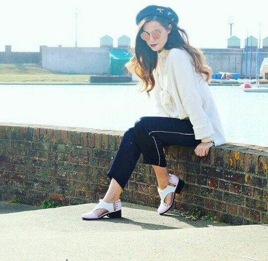 Marzia Bisognin | teashades | sunglasses | heels of her design | black beret | brick wall
