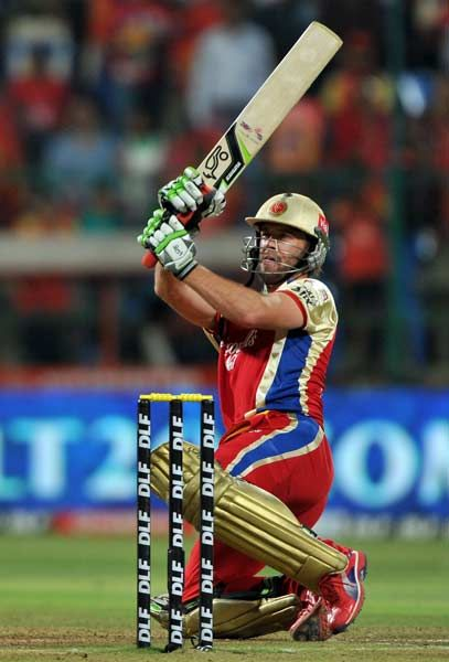 Royal Challengers Bangalore (RCB) batsman AB DeVilliers scores a boundary during the IPL Twenty20 cricket match between Royal Challenger Bangalore and Deccan Chargersat the M. Chinnaswamy Stadium in Bangalore on May 6, 2012.
