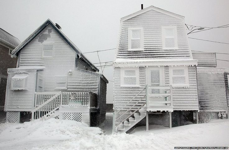 Frosted homes are battered by wind in Hull, Massachusetts