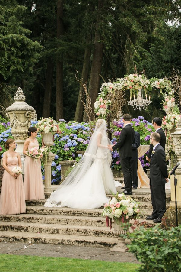 This Seattle soiree has all the major components of a modern day fairytale. Thornewood Castle as the backdrop? Check! Custom-designed Italian engagement ring? Check! Stunning Galia Lahav gown? Check! From the pink Aria Style blooms to the gorgeous glass slipper moment a la Valentino, every moment Stephanie Cristalli captured
