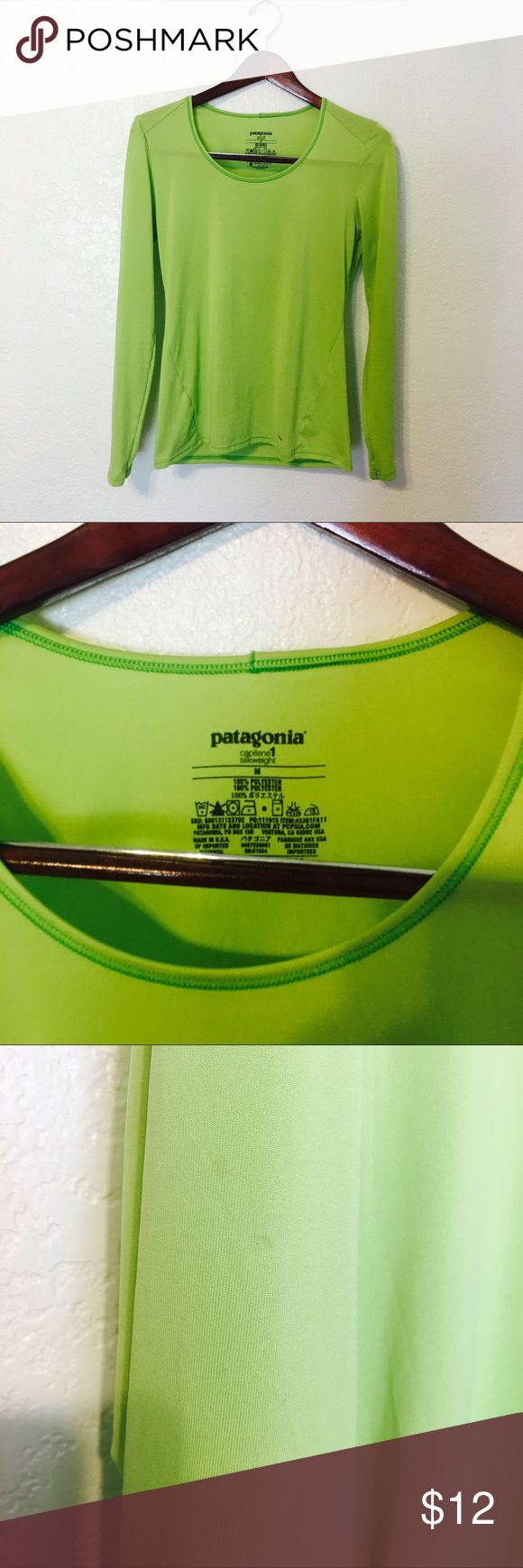 Patagonia shirt Moisture wicking Patagonia long sleeve shirt. Size medium. A few small spots that are hardly noticeable. Price is reflected Patagonia Tops