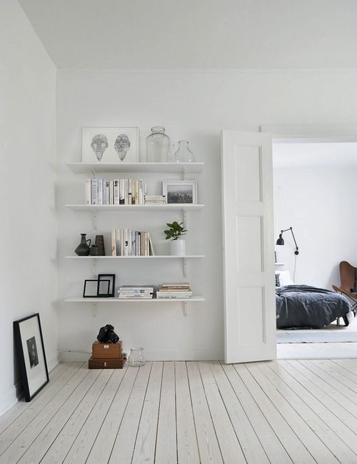 White shelves in white apartment