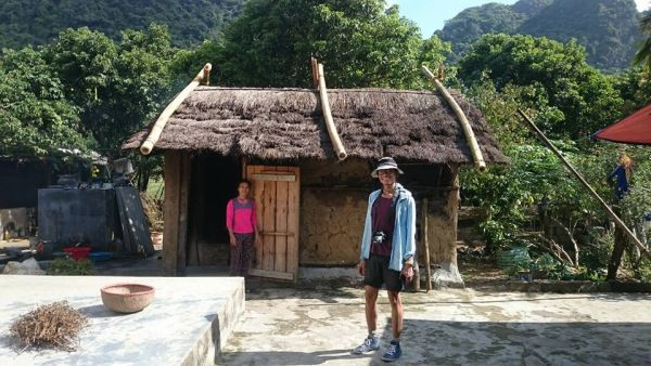 A local lady and I standing  in front of a mud house in Viet Hai village, Cat Ba archipelago in Northern Vietnam.