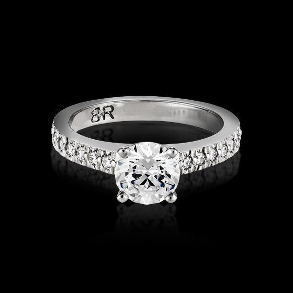 The Fulgeo engagement ring is a twist on the classic solitaire design, for those wanting a little more bling. The diamond band features approximately 16 full cut diamonds.