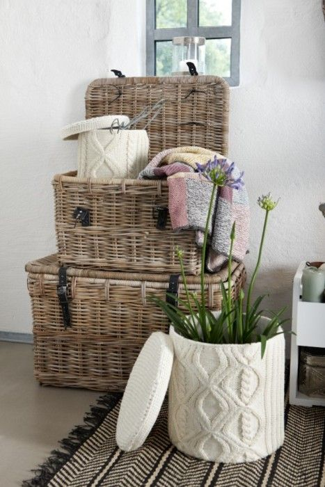 Loving the textures of these straw baskets but even more so the knitted hat boxes - they're fab.