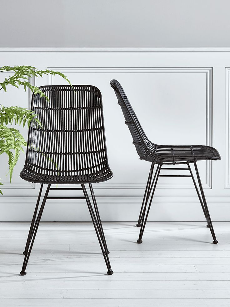 Inspired by classic 1950's design, our stylish flat rattan dining chair has a strong black iron frame and black painted rattan finish. Our contemporary twist on this classic Scandinavian design has been especially designed for your comfort with a wide, moulded seat and high back. Pair with our Round Oak Table and Monochrome Stoneware Dinnerware to complete the look.