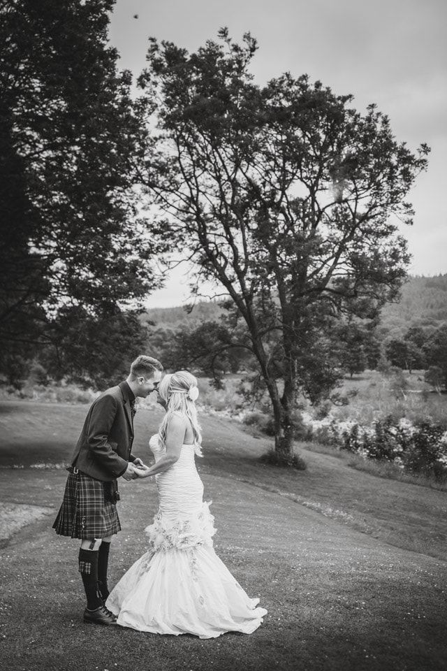 Banchory Lodge Wedding. Bride groom riverside woodland portraits. By Fotomaki Photography.