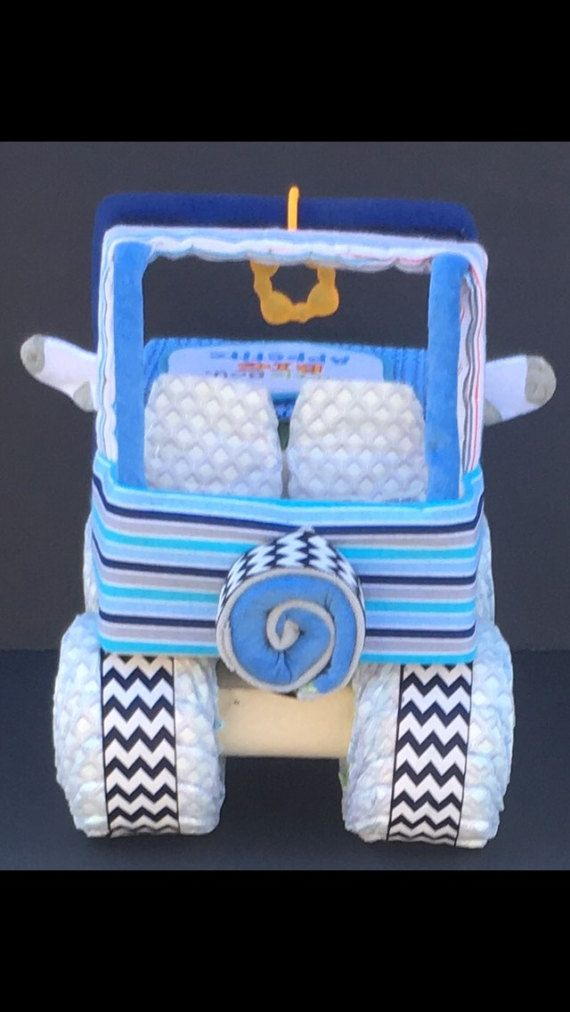 Blue Jeep diaper cake Looking for a gift NO ONE else will have?? This diaper jeep is PERFECT for your next baby shower! **********I have recently started making my own recieving blankets which gives ENDLESS possibilities for custom themes!! There are many options at checkout,