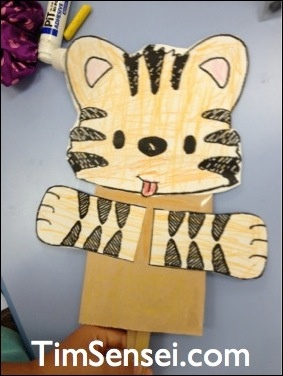 Tiger Puppet Craft. Take one paper bag, a tiger template and a growl and you have this simple yet enjoyable craft.
