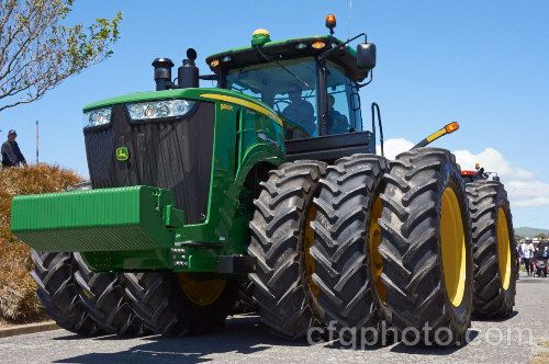 2012 John Deere 9510R, a large tractor, powered by a 824 cid 6 cylinder turbo-diesel motor producing a maximum of 561hp, that was introduced in 2011. It has a power shift transmission with 18 forward and 6 reverse gears and features all the latest innovations, such as GPS control and a fully climate-controlled cab. http://www.farmingstockphotos.com/img27415.htm