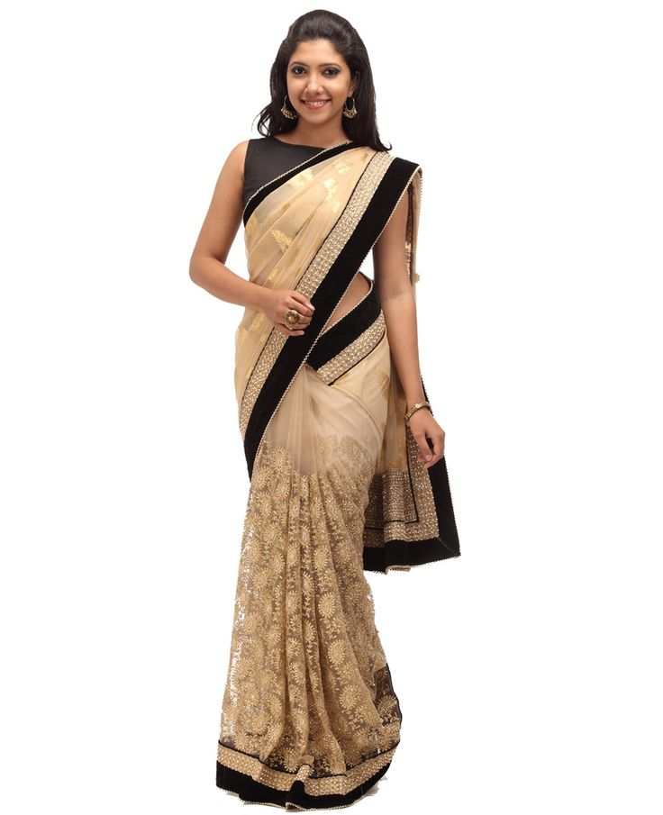 Net Partly Fancy Saree. Fabric is Crepe. Golden Color. Body is Crepe shimmer with golden designs with velvet black attached fancy border, pleats with golden thread n stone work. Border is velvet black attached fancy border with golden stone work and pearls. Pallu is crepe shimmer with golden designs with velvet black with saree border.