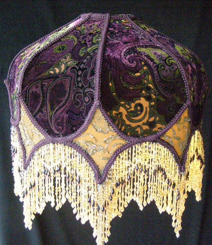 Victorian Eclectic Lampshade with Beaded Fringe. The top fabric on the shade is a burnt-out silk velvet.The colors in the fabric are purple, grape and apple green. The eight diamond panels are a gold beaded fabric. Double beaded fringe in gold and grape colors.