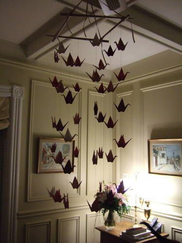 Craftster member Jeebles created this inspiring, modern-looking mobile from nothing more than hand-folded paper cranes, thread and ribbon, and a few chopsticks. Paper Crane Mobile Related: • HOW TO...