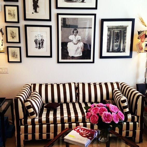 Luxuriate in the Living Rom. Black and gold stripes and a gallery wall. Carolina Herrera's studio.