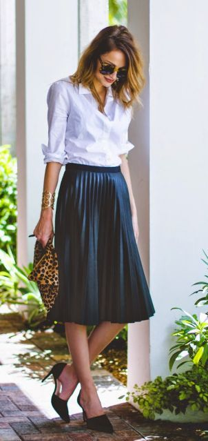 Taylor Morgan +  pleated skirt with heels and a white shirt  Shirt: J Crew, Skirt: Topshop, Heels: D'Orsay, Clutch: Clare Vivier Leopard.