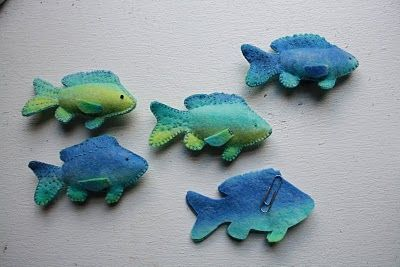 I've been sewing these little felt fish for the school's spring fair. They will be sold as part of a game that will include a fishing rod with a magnetic hook, all kept in a little bag that will also be the pond. I have to remember to sew in the paperclip so they will be caught!