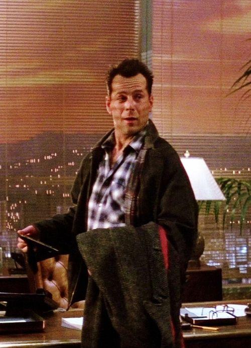 Bruce Willis as John McClane in Die Hard (1988)