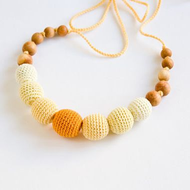 Yellow Ombre Nursing Necklace - The yellow ombre nursing necklace makes a cute gift for the holidays!   This necklace is 100% natural and it is made by covering wooden beads with a cotton yarn. The covered beads and smoothly polished juniper beads are threaded onto a satin ribbon to make the necklace strong. The juniper beads have a pleasant characteristic odor.