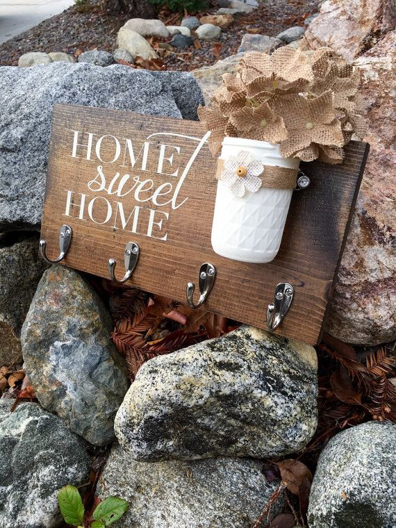 This adorable home sweet home sign measures 12 X 7.5. This is a made to order item so the exact sign pictured is not available, but one similar will