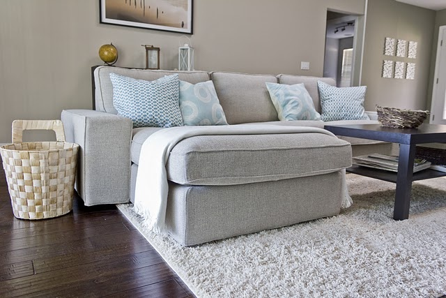 Grey couch to brighten up the room without a white couch that will be forever dirty!