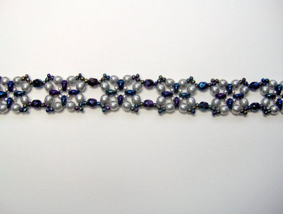 A really lovely bracelet using carnival blue iris firepolish facets, silver round glass beads, jet iris medium blue twin beads, galvanised silver and navy rainbow seed beads and finished with a silver plated lobster clasp. Length of bracelet including clasp is 21.5 cm (8.5 inches) which is comfortable for a 6.5 - 7 inch wrist. Width is 1.5 cm (0.6 inches). Please check the wrist size carefully before purchasing. Only this one size available. Bracelet will be in a black gift box and sent in…