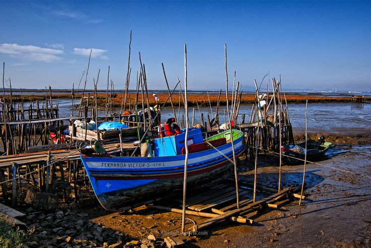 """Low Tide Porto Palafita da Carrasqueira - Stilt Port of Carrasqueira  Carrasqueira, Alentejo, Portugal  Situated the Natural Reserve of the Sado Estuary is the stilt fishing """"port"""" of Carrasqueira which gives access to boats at even at low tide. This traditional port has served as an anchorage for local fishing boats for more than two centuries."""
