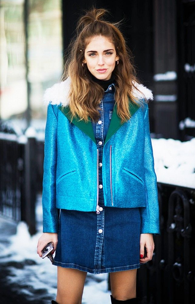 Chiara Ferragni wears a denim button-down dress, Rodarte motorcycle jacket, and knee-high boots