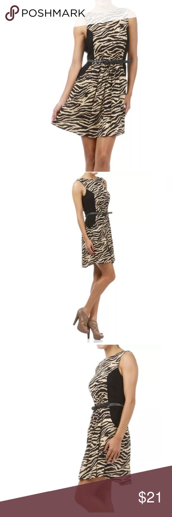 Animal Print Beige Studded Belt Dress NEW Featuring a black and beige animal printed dress. High neckline. Black side panels. Waist is slightly cinched with an elastic hem and decorated with a skinny black belt with rocket studs. Low v shaped backside. See the listing pictures for more detail. Short mini length.   Made of: 100% Rayon Dresses Mini