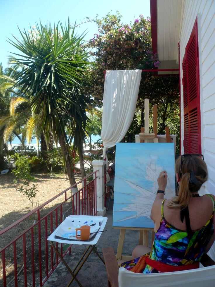 At the Metaxart studio painting at the veranda