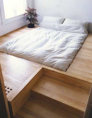 When thinking about flooring it pays to think outside the box. This crafty platform conceals storage, doubles as a sizable bedside table and, it appears, a neat little planter box.