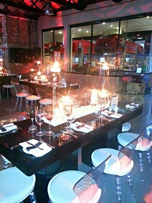 contemporary corporate function in a warehouse car dealership...http://www.venuesfor21stbirthdayparty.com/occasions/