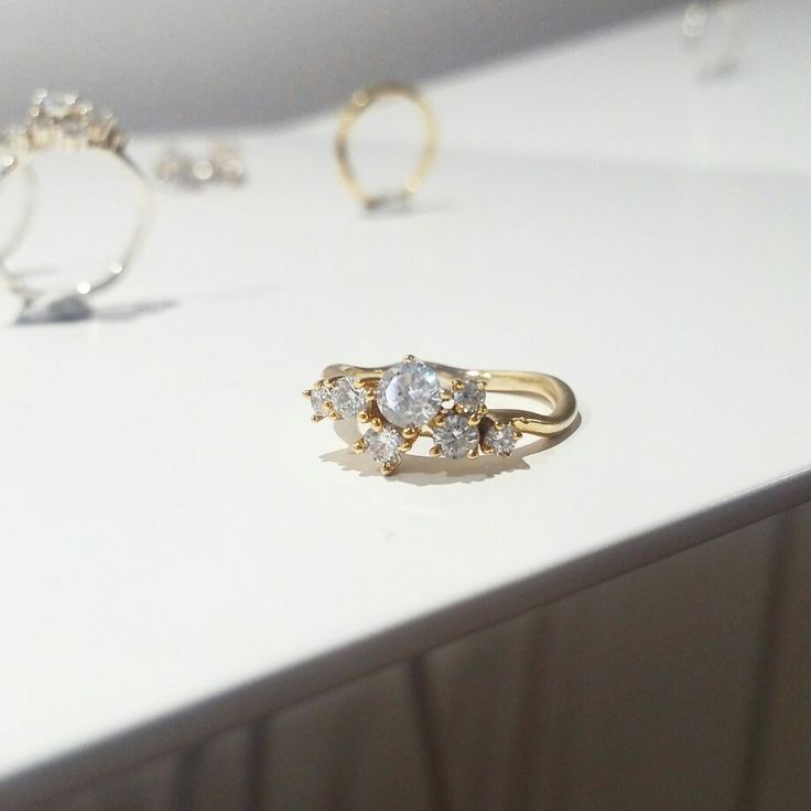 Diamond Cluster ring in yellow gold. An original way how to set diamonds and create unique engagement ring.