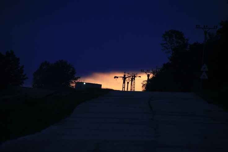 Electric Poles Silhouette at Sunset and Cloudy Sky