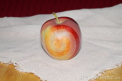Ripe red apple on a table