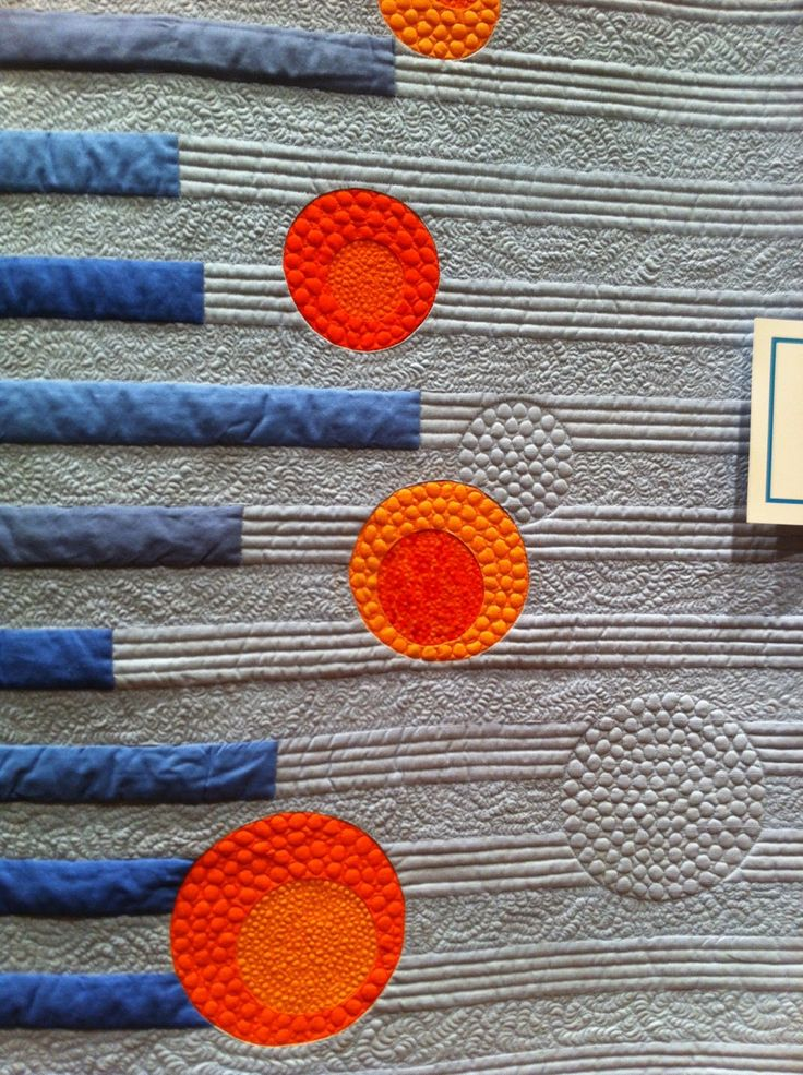 Spectacular quilting and colors from a quilt at the Lancaster Quilt Show. (Anyone know the artist or a better source?)