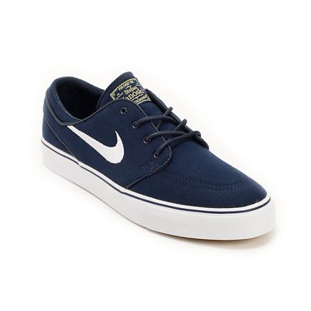 The classic low profile Stefan Janoski in a sleek all navy colorway with contrast detailing. Dark obsidian blue upper with matching round waxed laces and stitching, bright white vulcanized sole with matching navy foxing, Nike Zoom Air insole with air pocket, matching metal reinforced lace eyelets and piping, with light brown Janoski branding at tongue and white Nike Swoosh.