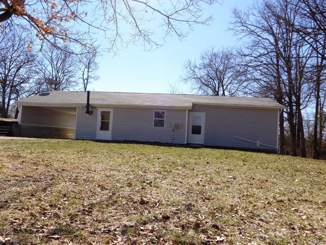 Just listed this cute little 2 Bedroom, 1 Bath County Cottage on 6.55 acres of land. Cozy living room has wood stove for supplemental heat, 2 decent size bedrooms, dining room close to newly remodeled kitchen, all kitchen appliances and one full bath. Stackable washer/dryer combination in mechanical room. Gas Forced Air Heat, Window Air Conditioners, Private Well, and Lagoon. Attached Carport. If you are looking for outbuildings, this home has Detached Garage/Workshop in Richland MO