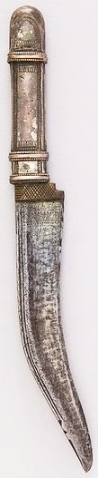Arabian shafra knife, 18th to 19th century, steel, silver, H. 9 13/16 in. (24.9 cm); H. of blade 6 1/4 in. (15.9 cm); W. 1 1/16 in. (2.7 cm); Wt. 4.3 oz. (121.9 g), Met Museum, Bequest of George C. Stone, 1935.