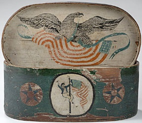 """The 13¼"""" oval, lidded patriotic ditty box is decorated with a sailor, an American flag, an eagle, stars, a schooner, and a bark. Dealer Patricia Stauble of Wiscasset, Maine, gave it a run, but in the end a phone bidder won it for $4248"""
