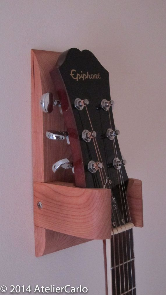 * DESCRIPTION  There are many types of guitar wall hangers around. This one has a sculptural element to it. The top and bottom are gently tapered