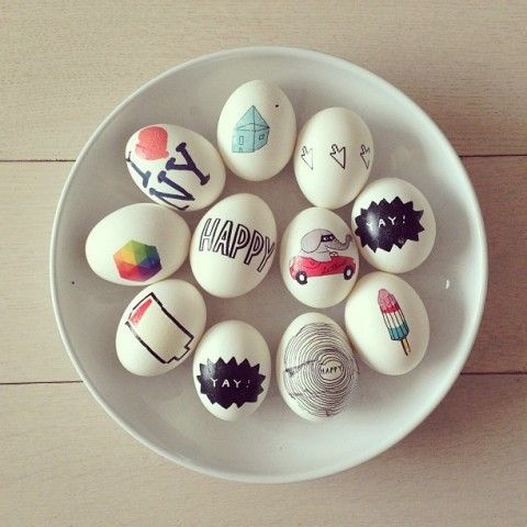 Easter eggs decorated with Tattly tattoos.