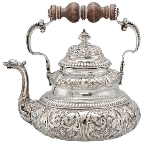 Dutch Silver Tea Pot with Dolphin Spout c1730 | From a unique collection of vintage coffee and tea sets at http://www.1stdibs.com/jewelry/silver-flatware-silverplate/coffee-tea-sets/