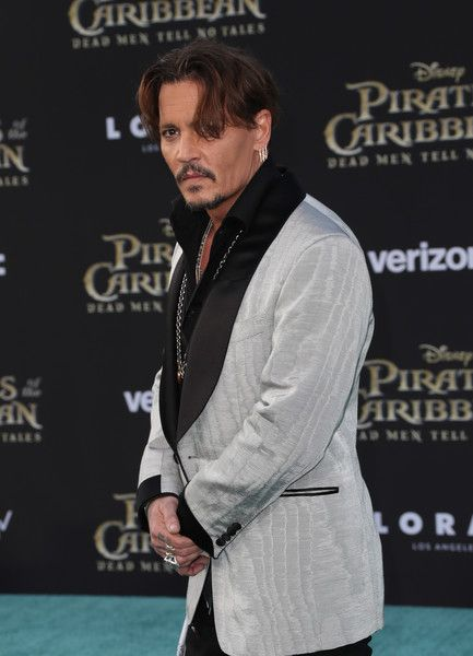 """Johnny Depp Photos Photos - Actor Johnny Depp attends the premiere of Disney's """"Pirates Of The Caribbean: Dead Men Tell No Tales"""" at Dolby Theatre on May 18, 2017 in Hollywood, California. - Premiere of Disney's """"Pirates of the Caribbean: Dead Men Tell No Tales"""" - Arrivals"""
