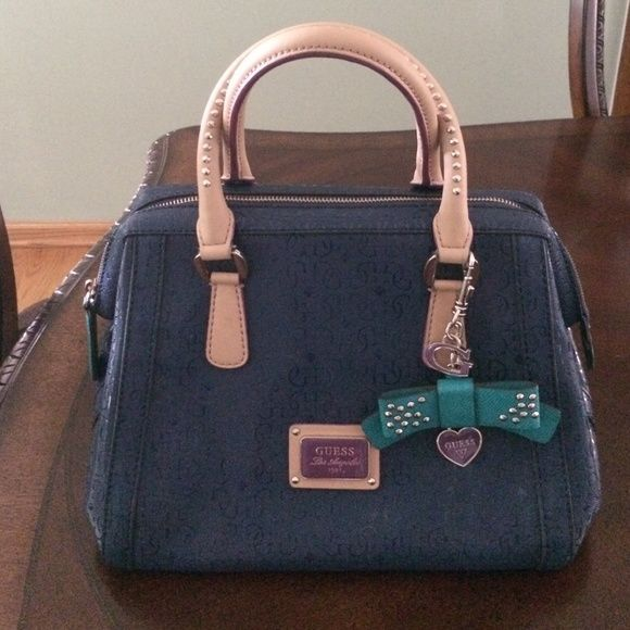 Guess handbag with matching wallet Cute colorful Guess handbags with matching wallet & cross body strap hardly ever used in amazing condition! Guess Bags