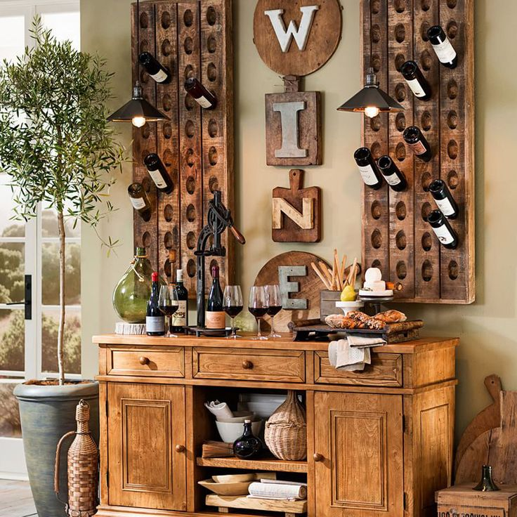 These rustic riddling racks are crafted from mango wood with a knotty finish and can hold up to 60 lbs of filled bottles, empty bottles as artful wall decor, or just use them as vertical succulent gardens.