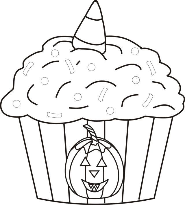 A halloween cupcake with a jack-o-lantern and a candy corn ...