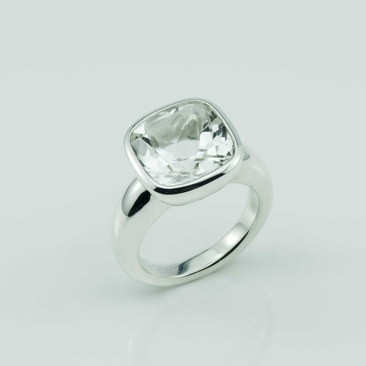 Our custom faceted 6.54 carat (12mmx12mm) cushion cut Clear Quartz has been bezel set in our Argentium Silver ring